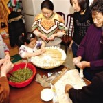 Family making dumplings