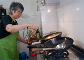 Terry trying her hand at the wok